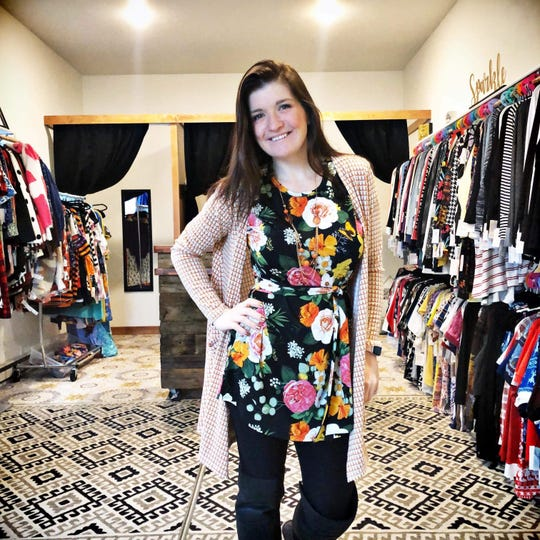 Jenny Brandenburg posing in Sparkle Boutique, her store in Sturgeon Bay.