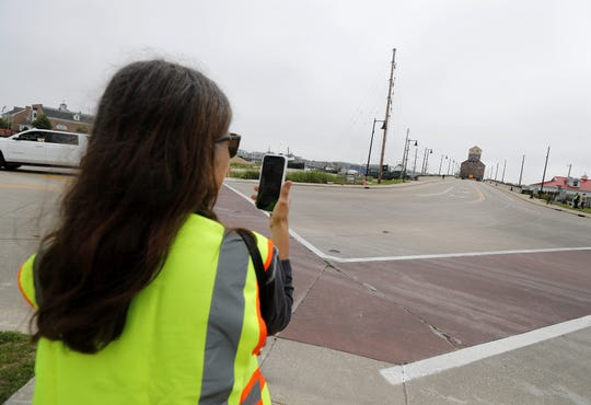 Christie Weber, Sturgeon Bay Historical Society president, runs a Facebook live as the 1901 Teweles and Brandeis Granary makes its way down the Oregon Street Bridge Monday, June 24, 2019 in Sturgeon Bay, Wis.
