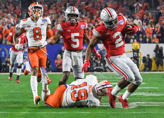 Former Ohio State running back J.K. Dobbins, seen during the College Football Playoff semifinal against Clemson, could go to the Miami Dolphins with one of their first-round picks in April's NFL Draft.