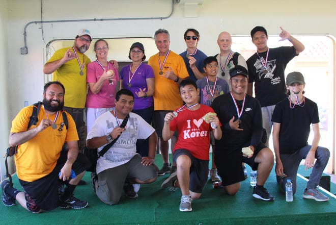 The Chamorro District of the Scouts BSA completed their annual scavenger hunt in Hagåtña on Dec. 28.  The hunt incorporated a Chamorro heritage walking trail representing about three thousand years of history from 1687 BC to present. The journey included identifying plants and animals, poisonous plants, catching fish and crabs, using orienteering skills, measuring height from a distance, geocaching and finding golden nuggets and a home run baseball for extra points. Pictured: First place team Troop 007. They won the hunt two years in a row and the hunt was designed by scouter Roy Tsutsui. From left, back row: George Waibel, Melissa Waibel (found home run baseball), Wanda and Bill Davis, Will Larsen, Jude Salas, Jared Wilson, Matthew Castro. Front row:  Kawika Davis, Keith Kalima, Jace Salas (found gold nugget), Kipatson Martinez (found gold nugget) and Eli Larsen.