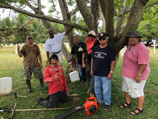 Members of the Guam U.S. Air Force Veterans Association presented a special Christmas gift to their fellow veterans and their families, by cleaning and cutting grass at their final resting place, Hagåtña Veterans Cemetery. From left: Bill Cundiff, Joe Foster, Capt. Quenga, Ray Salas, Henry Manglona, Al Perez, and kneeling volunteer Ben Manglona.