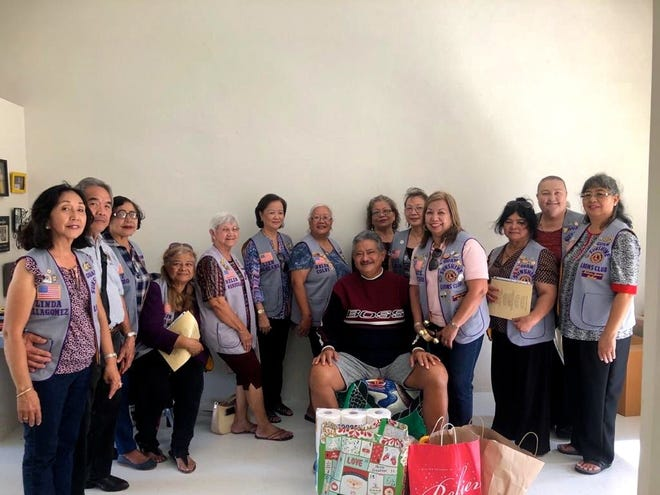Members of the Guam Sunshine Lions Club Visited Rodney Cruz (seated center), 60, of Guma Trankilidat in Tumon on Dec. 7.  Supplies, song, and cheer were provided by the members.
