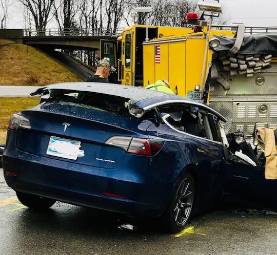 A 23-year-old woman died and her 25-year-old husband was injured when a 2019 Tesla he was driving struck the rear of a parked fire engine on I-70 on Sunday, Dec. 29, 2019.