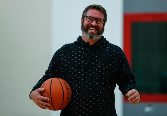 Nate Muterspaugh smiles for IndyStar at a Family Fitness, Mt. Vernon, Ind., Saturday, Dec. 21, 2019. Now in his 40s, Nate Muterspaugh has drained three half court shots in the gym where he played high school ball.