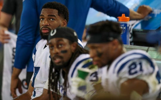 Jacoby Brissett (left) and teammates sit on the bench and watch as the Jacksonville Jaguars drive down the field late in the game at TIAA Bank Field in Jacksonville, Fla., on Sunday, Dec. 29, 2019.