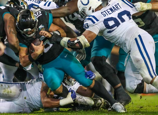 Jacksonville Jaguars quarterback Gardner Minshew II (15) is sacked by the Indianapolis Colts defense at TIAA Bank Field in Jacksonville, Fla., on Sunday, Dec. 29, 2019.