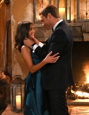 "Hannah Ann Sluss and Peter Weber embrace on ""The Bachelor."""