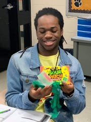 James Elliott shows off the candy he received.