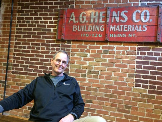 Gordon Heins poses in the conference room that will be refurbished to commemorate the 100th anniversary of A.G. Heins Co.