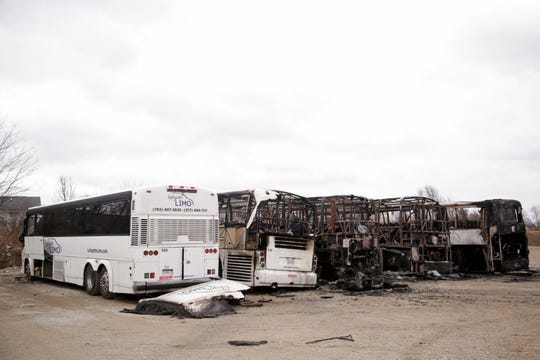 The charred remains of five coach buses sit in the lot of Lafayette Limo after an early morning fire, Monday, Dec. 30, 2019 in West Lafayette.