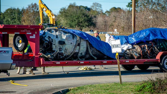 Clean up crews pick up wreckage from the plane crash that happened Saturday, Dec. 28, 2019.