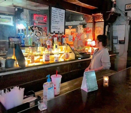 Bartender Dee Ison on Saturday prepares for what was set to the be the last day of business for Leo's Bier Haus. Co-owner Karen Glasser said she is retiring.