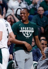 Michigan State's Cassius Winston, facing, congratulates Foster Loyer, left, as he comes out of the game against Western Michigan during the second half of an NCAA college basketball game, Sunday, Dec. 29, 2019, in East Lansing, Mich. Winston sat out with an injury. Michigan State won 95-62. (AP Photo/Al Goldis)