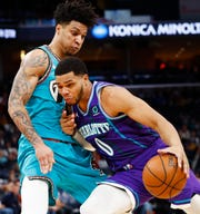 Memphis Grizzlies forward Brandon Clarke defends a drive by Charlotte Hornets forward Miles Bridges during their game at the FedExForum on Sunday, Dec. 29, 2019.