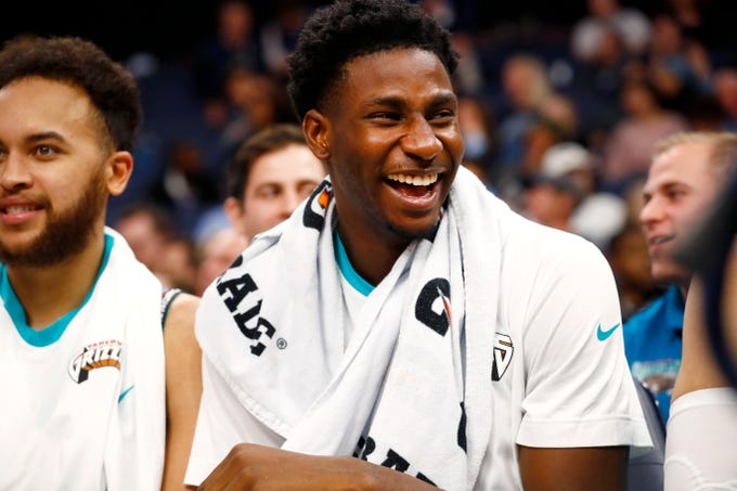 Memphis Grizzlies forward Jaren Jackson Jr. shares a laugh with his teammates from the bench as they take on the Charlotte Hornets at the FedExForum on Sunday, Dec. 29, 2019.