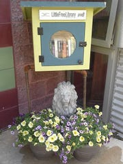 Kathie Giorgio's third literary lion was stolen in November.