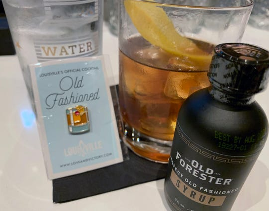 Old fashioned-themed lapel pins and a special bitters mix emanate from Louisville.