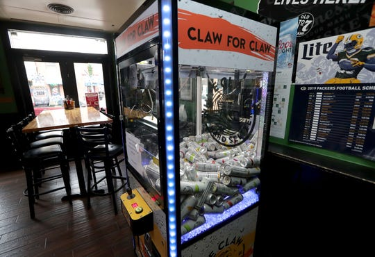 The Claw for Claw White Claw Hard Seltzer machine at Jack's American Pub at 1323 E. Brady St. in Milwaukee, as shown on Dec. 30, 2019.