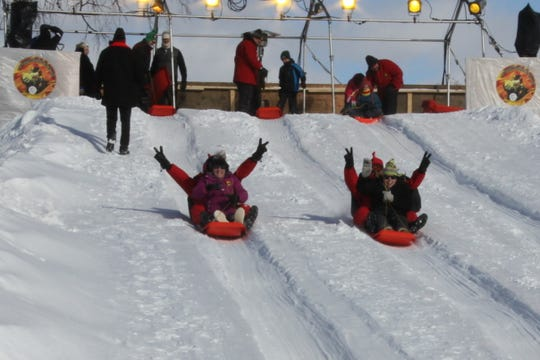 During the St. Paul winter carnival, the Vulcan Snow Park hosts family activities, including a snow slide.
