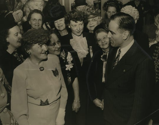 "Joseph McCarthy, then Republican candidate for U.S. Senate, chats with attendees at a Republican women's ""card party"" at Milwaukee's Pfister Hotel. on Nov. 1, 1946. About 2,000 women attended the event, booked for space that had room for 1,400. Four days later, McCarthy won the race in an upset over incumbent  Wisconsin Sen. Robert La Follette Jr. This photo was published in the Nov. 2, 1946, Milwaukee Sentinel."