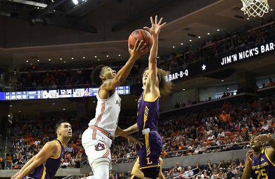 Auburn guard Jamal Johnson (1) hits a layup in the second half against Lipscomb on Sunday, December 29, 2019 in Auburn, Ala.