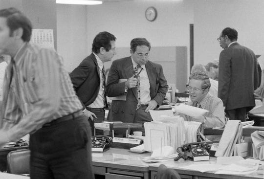 This June 15, 1971 file photo shows the city room of the New York Times after a federal judge ordered the paper to temporarily cease publication of a series of articles on the Vietnam War based on a Pentagon study. From left are Times editors James L. Greenfield, foreign editor; Max Frankel, chief Washington correspondent; and Fred P. Graham from the Times Washington bureau. Graham died at his Washington home over the weekend.
