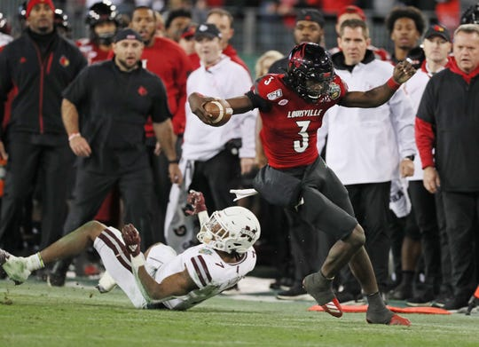 Louisville quarterback Micale Cunningham (3) rushes for a first down against Mississippi State during the second half of the Music City Bowl at Nissan Stadium in Nashville, Tenn., on Monday, Dec. 30, 2019.