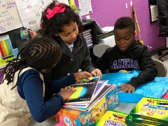 Students at Cane Ridge Elementary in Antioch marvel over the new school supplies delivered to their classroom as part of The Tennessean's Adopt-a-Teacher initiative.