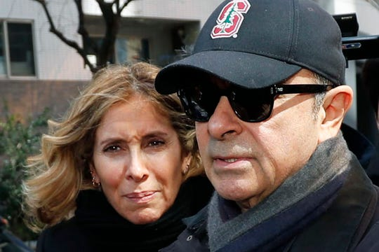 This March 2019 file photo shows former Nissan Chairman Carlos Ghosn, right, and his wife Carole in Tokyo.  Ghosn, awaiting trial in Japan on financial misconduct charges, has received permission from a Tokyo court to talk for one hour in a video call with his wife.