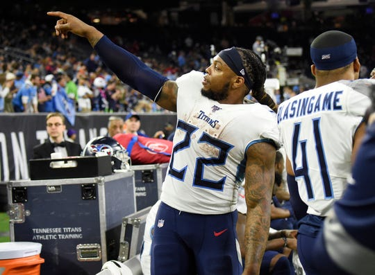 Tennessee Titans running back Derrick Henry (22) points to the crowd late in the game against the Houston Texans at NRG Stadium Sunday, Dec. 29, 2019 in Houston, Texas.