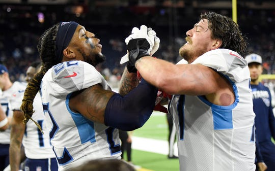 Tennessee Titans running back Derrick Henry (22) and offensive tackle Taylor Lewan (77) celebrate after Henry's touchdown against the Houston Texans during the fourth quarter at NRG Stadium Sunday, Dec. 29, 2019, in Houston, Texas.