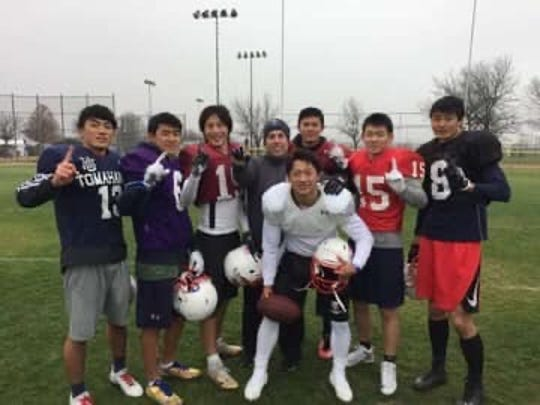 P.J. GIbbs poses with his defensive backs in this 2017 photo. Gibbs served as the defensive backs coach for Team Japan in the 2017 International Bowl. He'll be the head coach for Japan in this year's game, to be held Jan. 15 at AT&T Stadium in Arlington, Texas.