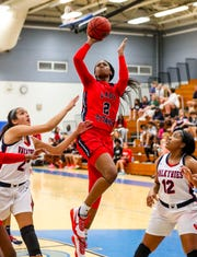 Janiah Barker, Tampa Bay Tech, looks to score. Sacred Heart Academy, Louisville, KY, beat Tampa Bay Technical High School during their game Monday afternoon in the Naples Holiday Shootout at Barron Collier High School.