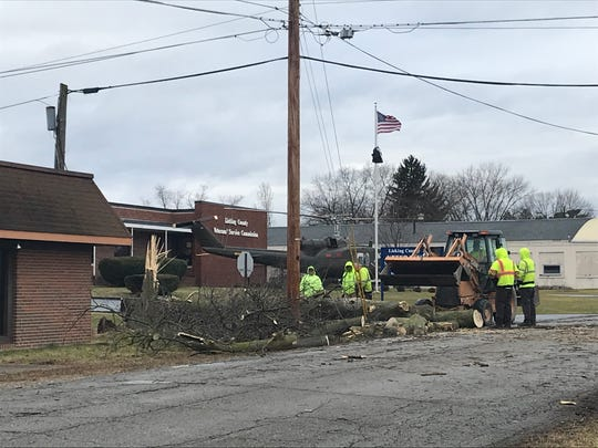 Newark Street Department employees clear a fallen tree from near the Licking County Veteran's' Services Commission Building on Monday, Dec. 30, 2019.
