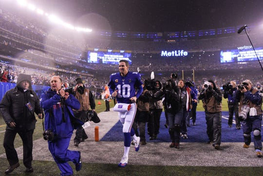 New York Giants quarterback Eli Manning (10) runs off the field at MetLife Stadium for possibly the last time. The Eagles defeat the Giants, 34-17, on Sunday, Dec. 29, 2019, in East Rutherford.