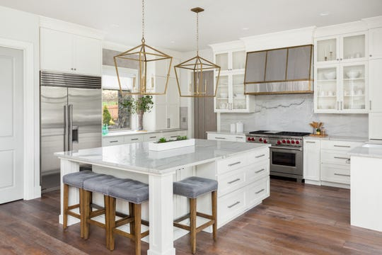 What's getting larger? Light fixtures. Lyn Peterson has installed huge chandeliers in kitchens and bedrooms.