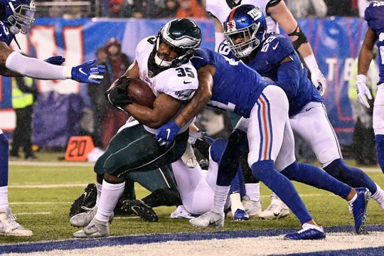Philadelphia Eagles running back Boston Scott (35) rushes for a touchdown against the New York Giants in the second half. The Eagles defeat the Giants, 34-17, on Sunday, Dec. 29, 2019, in East Rutherford.