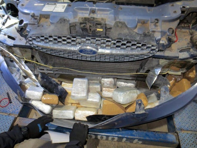The marijuana was hidden in the front and rear bumpers, and doors, of a 200 Ford Taurus.