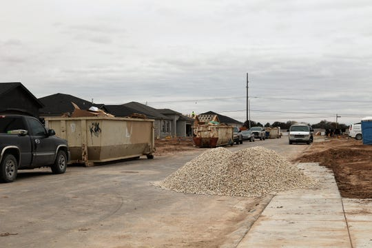 An entire neighborhood's worth of new housing goes up near the Old Cavern Highway on the south end of Carlsbad, New Mexico, Monday, Nov. 11, 2019.