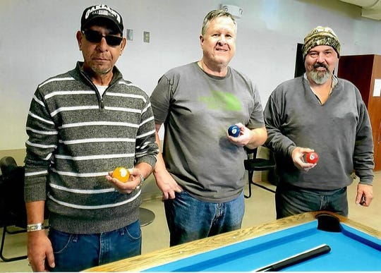 The December 2019 eight-ball billiard's tournament winners, from left: 1st place Carlos Hernandez, 2nd place Steve Richards and 3rd place Kelly Smith