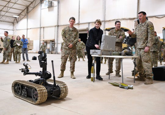 Secretary of the Air Force Barbara M. Barrett drives a bomb disposal robot used by the Explosive Ordnance Disposal Team deployed to the 724th Expeditionary Air Base Squadron during her visit to Nigerien Air Base 201, Niger, Dec. 21, 2019. While at the installation, Barrett learned how each unit supports the mission from building the future of the base to defending its assets and personnel.