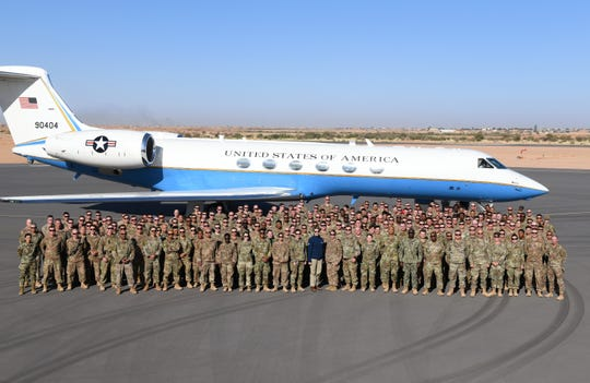 Secretary of the Air Force Barbara M. Barrett and service members deployed to Nigerien Air Base 201 pose for a photo in Agadez, Niger, Dec. 21, 2019. While at the installation, Barrett learned how each unit supports the mission from building the future of the base to defending its assets and personnel.