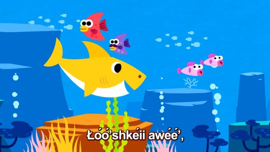"The name of Baby Shark is shown in the Navajo language in this shot from the ""Baby Shark Navajo"" video."