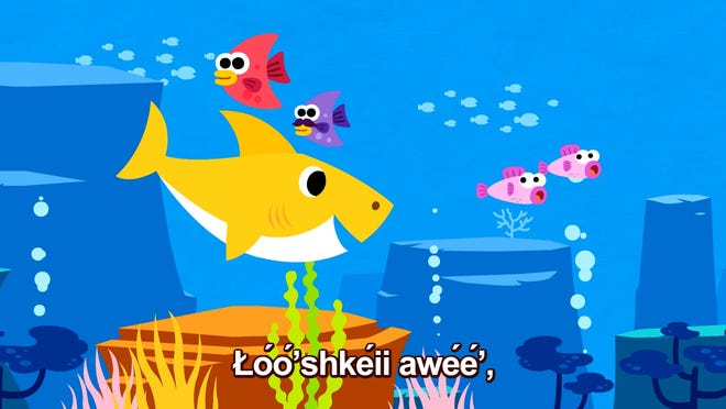 """The name of Baby Shark is shown in the Navajo language in this shot from the """"Baby Shark Navajo"""" video."""