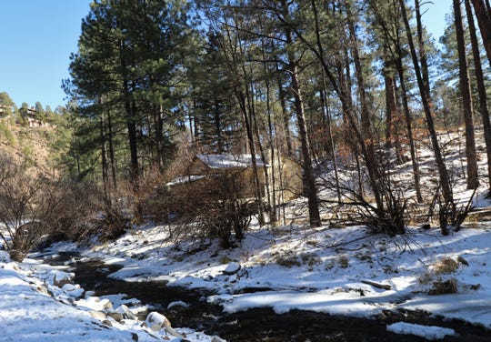 The Rio Ruidoso banks are covered with snow after the Village saw one to three inches on Dec. 28.