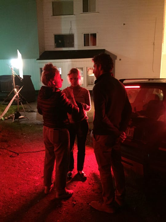 Stefanie Abel Horowitz, director of 'Sometimes, I Think About Dying,' talks to actors Jim Sarbh and Katy Wright-Mead on set in Maine.