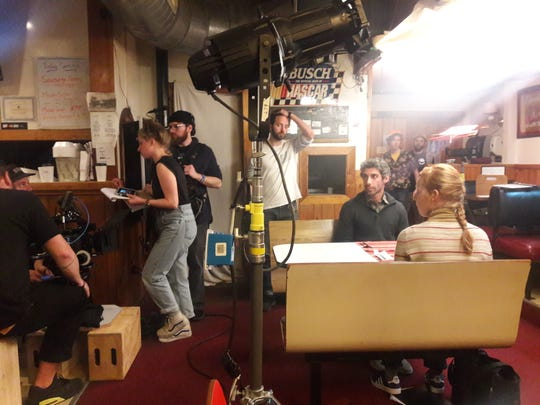 The cast and crew of 'Sometimes, I Think About Dying' on set in Maine. Director Stefanie Abel Horowitz, a Birmingham native, is standing at left.