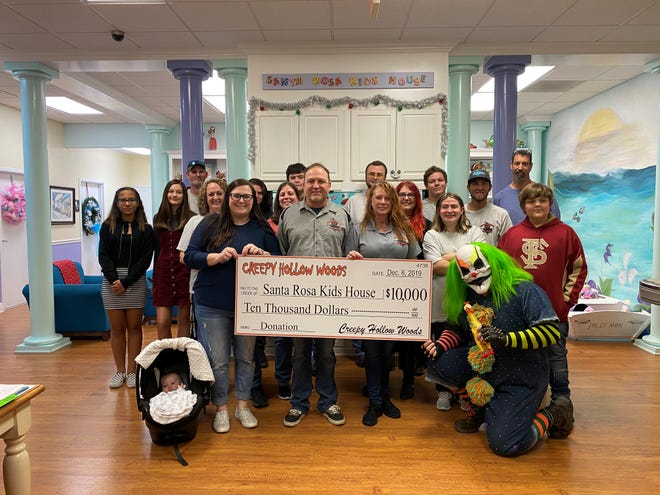Santa Rosa Kids' House receives $10,000 donation from Creepy Hollow Woods.