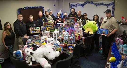 Escambia County Corrections collected over 200 toys during their third annual Toys for Tots drive.