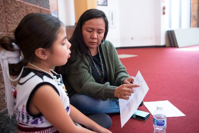 """In this Dec. 8, 2019, photo, Katrina Begay practices lines with her daughter Drew Wilson at """"Baby Shark"""" auditions at the Navajo Nation Museum in Window Rock. Begay and her daughter traveled from Rock Point, Arizona, to audition for the roles of Mama Shark and Baby Shark."""
